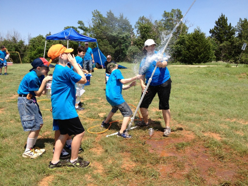 Webelos launching water rockets